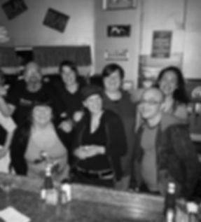 A black and white photo of few of our staff with the lovely Suzanne