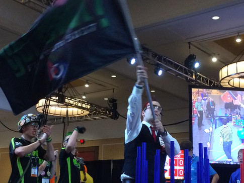 The emcee waving our flag