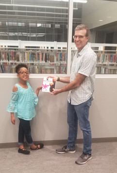 KayLee Michelle donating a copy of Let's