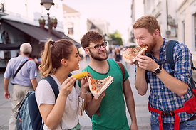three-young-people-eating-pizza