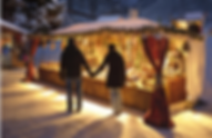 A-couple-walks-in-a-Christmas-market