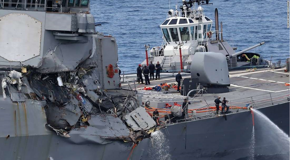 © STR/AFP/AFP/Getty Images This picture shows damages on the guided missile destroyer USS Fitzgerald off the Shimoda coast after it collided with a Philippine-flagged container ship on June 17, 2017.