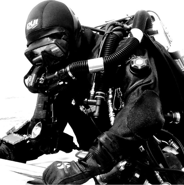 Capt Tom McCarthy boarding Tempest on a rEvo Rebreather