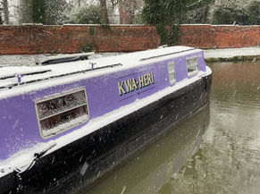 Snow on the Purple Boat