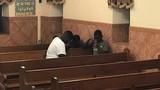 Youth group boys praying