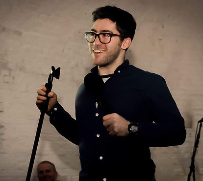 Aaron Simmonds on stage.jpeg