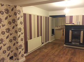 Loughton living room wallpapered