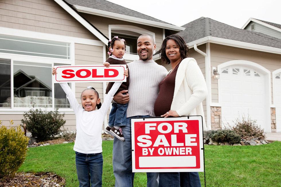 family-w-sold-sign.jpg