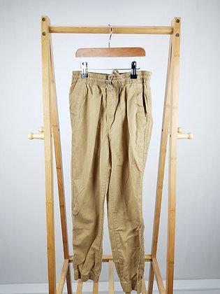 Beige cuffed trousers 10 years