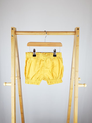 M&S yellow shorts 12-18 months
