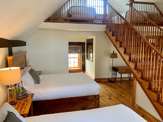 Photo of two queen and loft in Room #6.