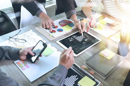 digital marketing people look at graphs and statistics 2018