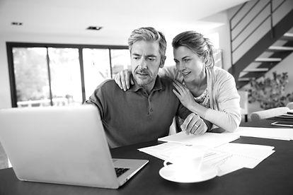 Couple calculating financial savings on