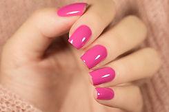 Manicure withpink nail Polish on women's