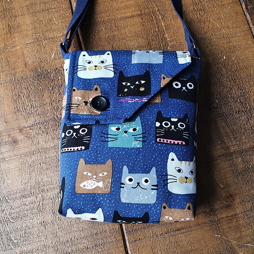 Cross body bag featuring crazy cat faces