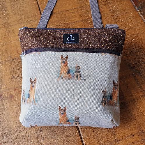 German Shepherd and puppy bag