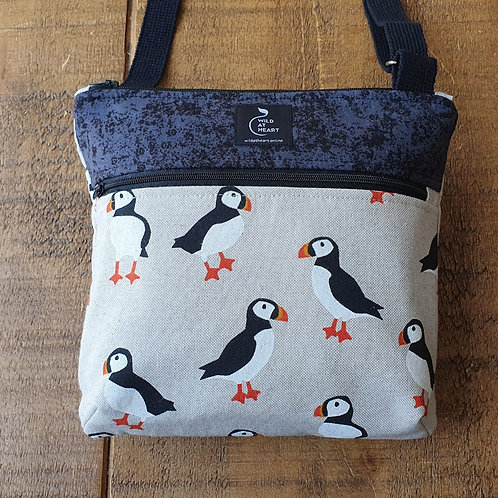 Puffin cross body bag with zipper pockets