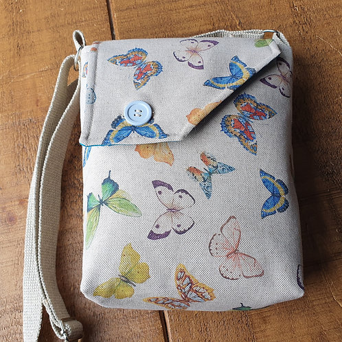 Canvas cross body bag with multi-coloured butterflies