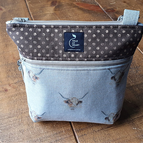 Cross body bag featuring highland cow fabric and two large zipped pockets