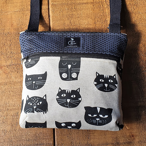 Black cross body bag with different cat faces
