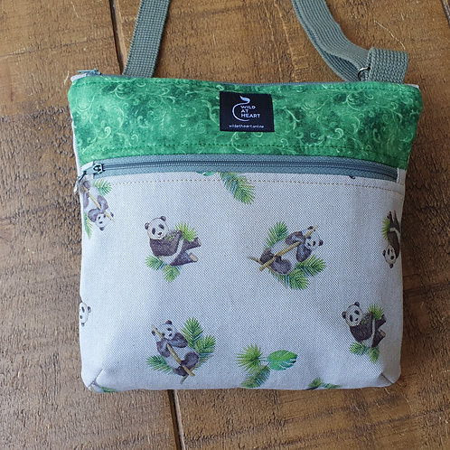 Panda cross body bag with two zipped pockets and green feature elements