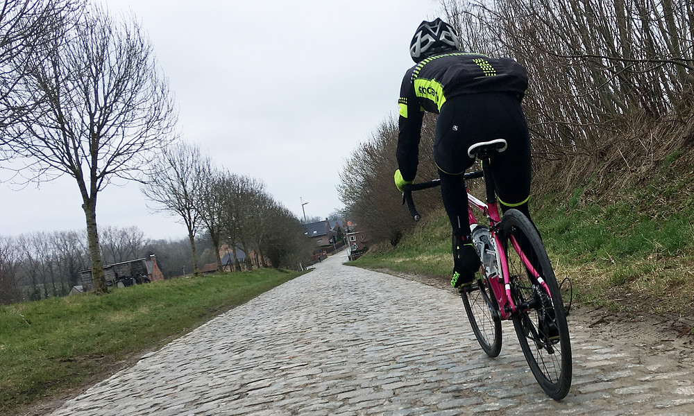 Chris eating up the cobbles