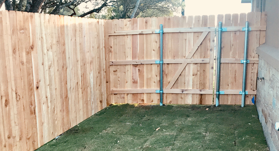 custom privacy fence with residential side yard gate