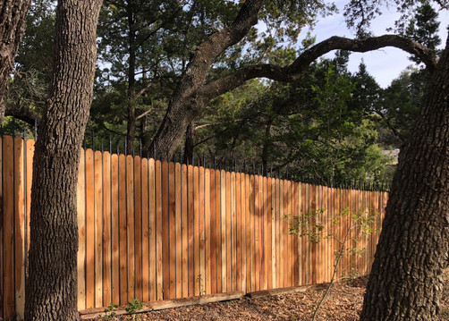 custom wood and wrought iron residential fence design