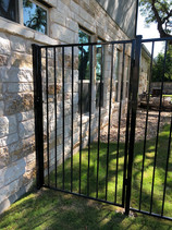 residential iron gate attached to the side of the house
