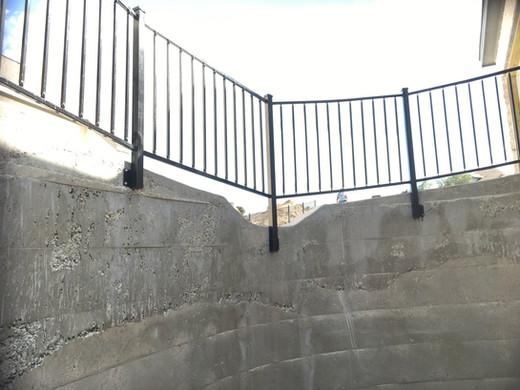 Wrought iron railing on concrete installation