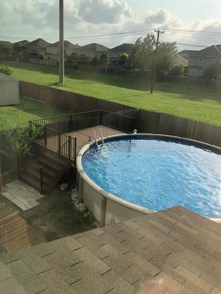 custom backyard above ground pool deck.j