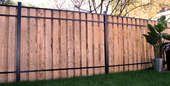 custom wood privacy fence with iron details