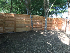 horizontal wood privacy fence and gate