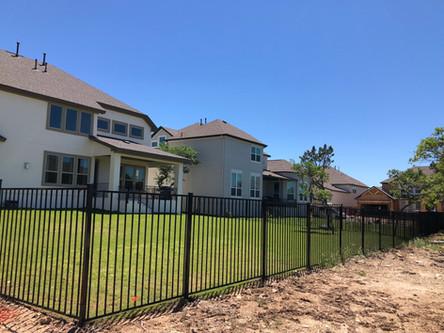 residential neighborhood wrought iron fence installation austin tx