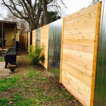 custom designed horizontal wood panel fence installation by sagamore fence and deck