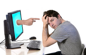 young worried man in stress with compute