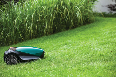 robotic mower cutting lawn on slope