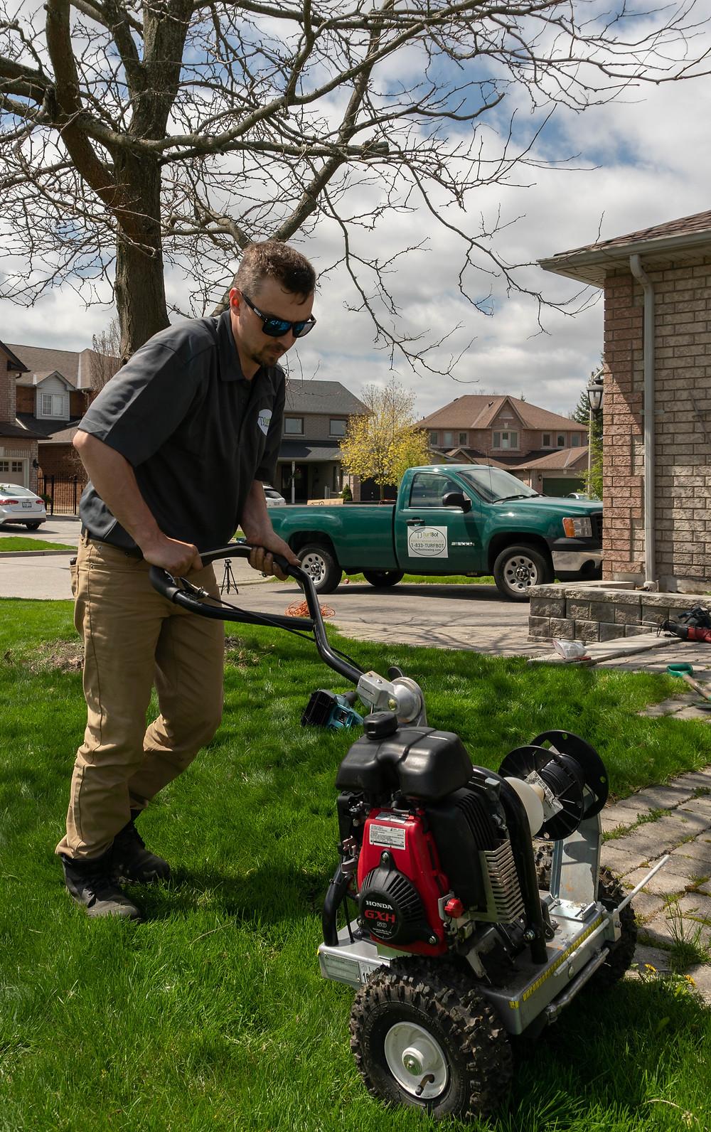 TurfBot technician installing robotic lawn mower
