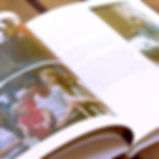 A close up of a custom designed photo book telling a vacation story.