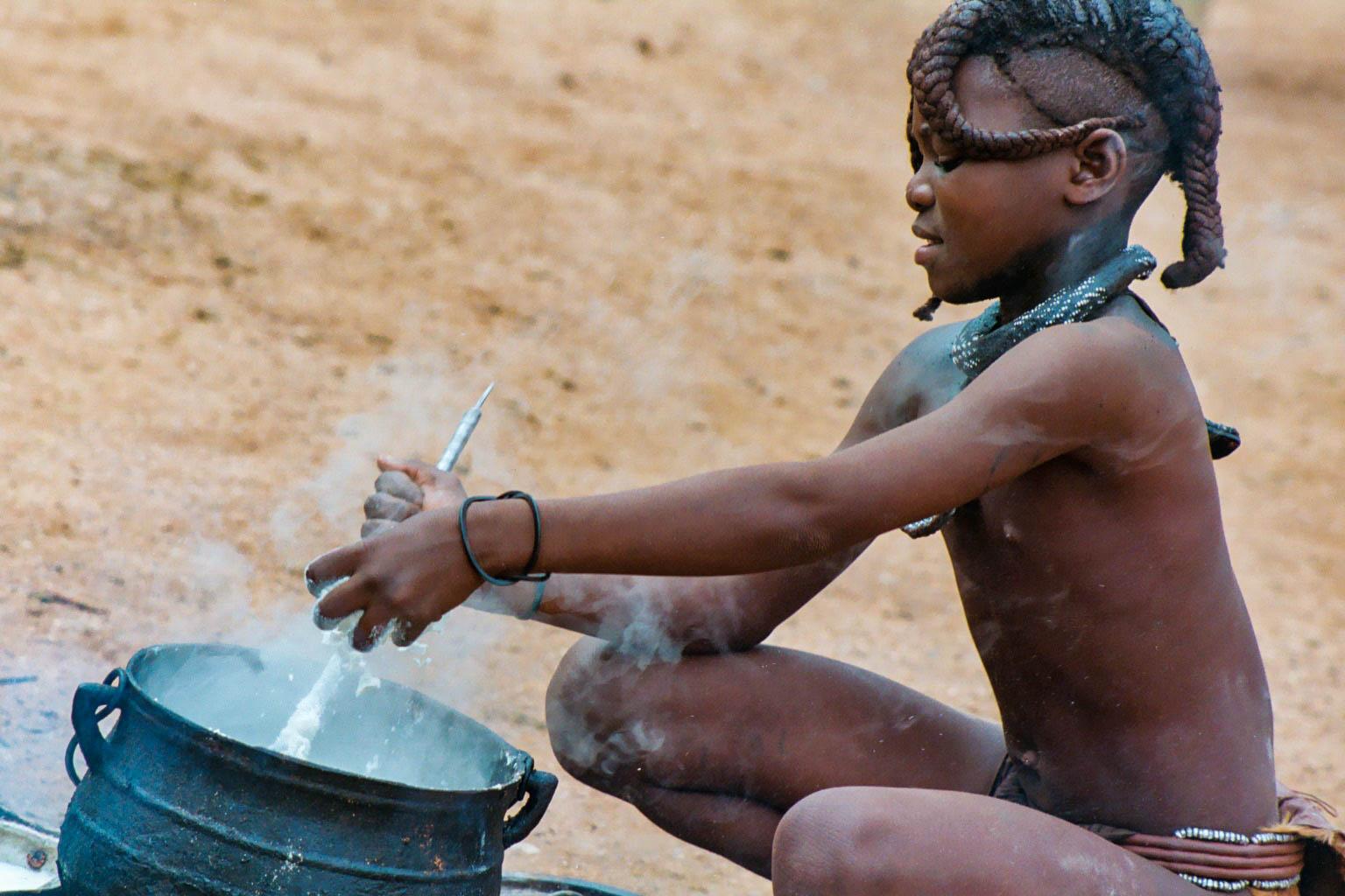 Himba girl cooking, Namibia