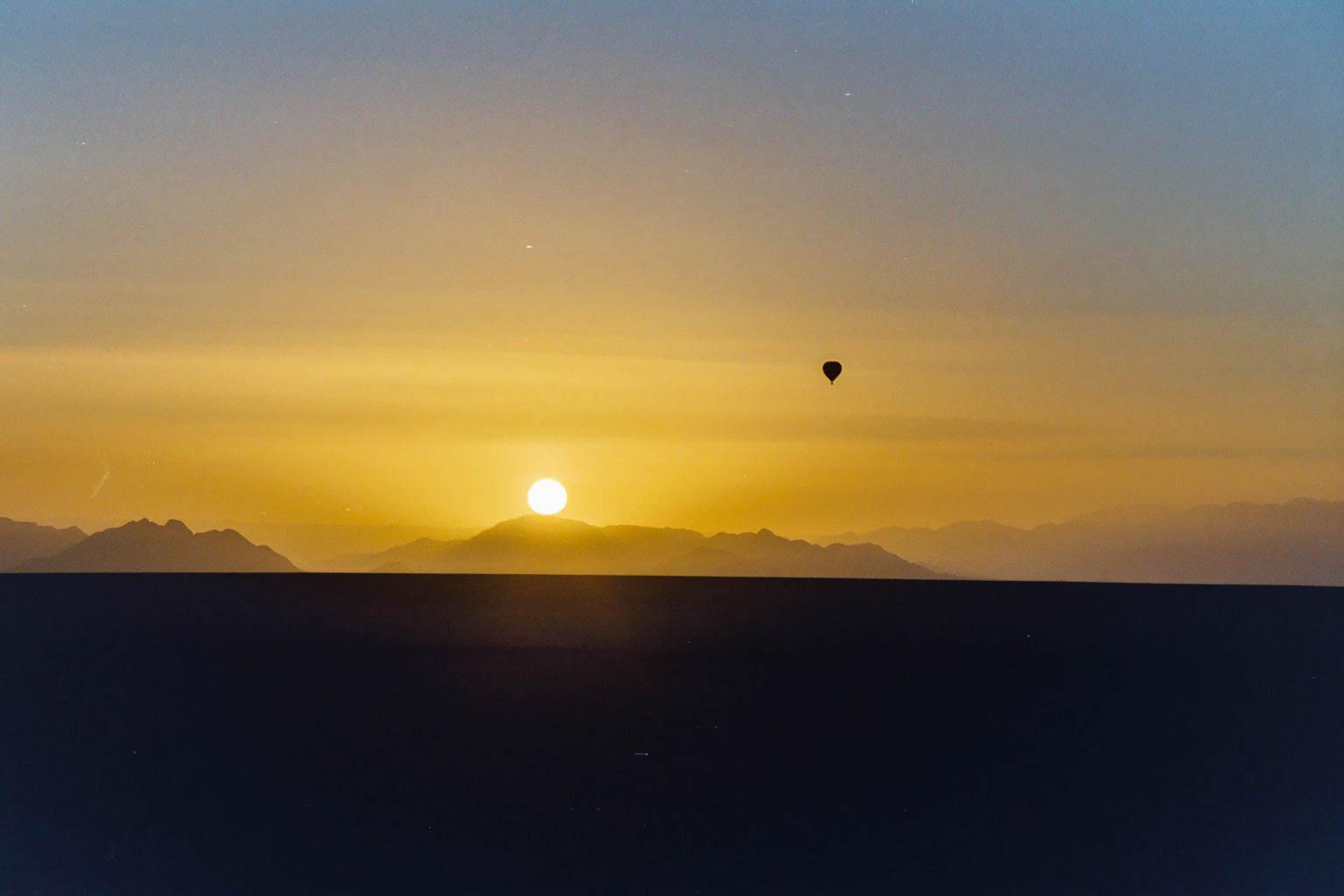 Hot air balloon at sunrise, Namibia
