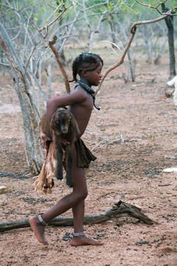 Himba girl with goat, Namibia