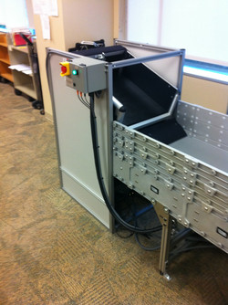 Transport bin inducting onto system