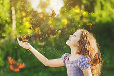 Laughing cute child with a butterfly on