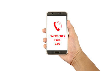 Hand holding a smartphone with text emer
