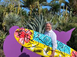 Stefan Szczesny holding one of his Surfboards.