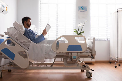 male-patient-in-bed-at-the-hospital.jpg