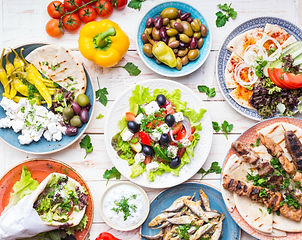 Greek food background. Meze, gyros, souvlaki, fish, pita, greek salad, tzatziki, assortmen