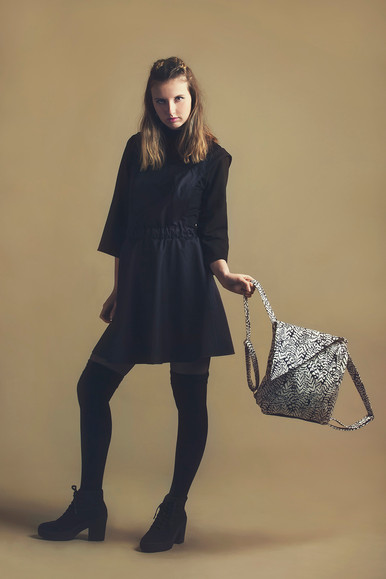 Black pinafore & feather backpack