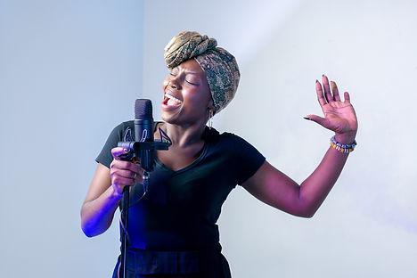 photo-of-woman-singing-in-music-studio-2